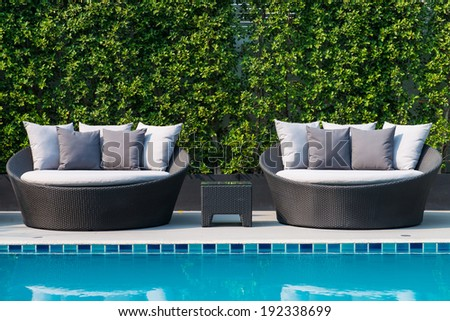 circular daybed and Swimming pool  - stock photo