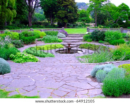 Circular Herb Garden with Fountain.  Dunedin Botanic Gardens, Dunedin, New Zealand.