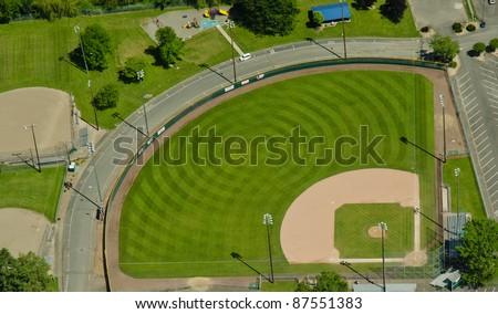 Circular mowing pattern in a baseball field - stock photo