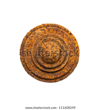 circular plate of rusty metal