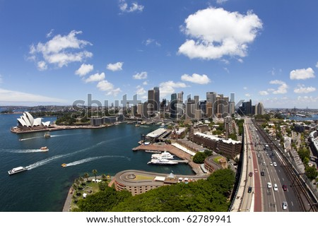 Circular Quay business district in Sydney Australia with a ferry entering the harbor - stock photo