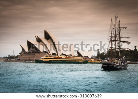 CIRCULAR QUAY, CBD, SYDNEY, AUSTRALIA - DECEMBER 27, 2014: Sydney Opera House situated in city harbour called Circular Quay - historical boat and local transport ferries in forefront, view from jetty - stock photo