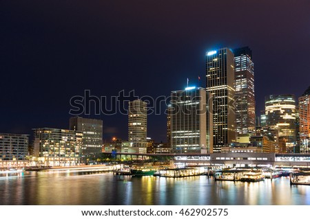 Circular Quay wharf with Sydney skyline at dusk. Modern cityscape and infrastructure, NSW, Australia