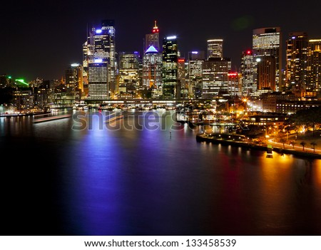 Circular Quay with reflections in the bay waters, Sydney, New South Wales, Australia.