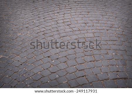 Circular radiating brick walkway in a park. - stock photo