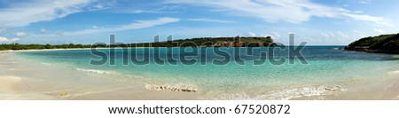Circular sandy bay off the south west coast of Puerto Rico by Los Morillos Lighthouse - stock photo