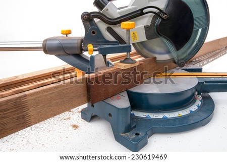 Circular Saw cutting wood 45 degree  - stock photo