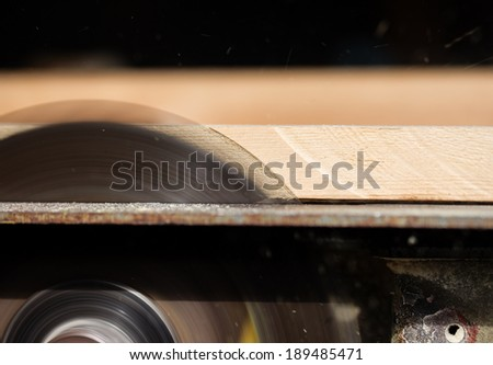 Circular saw cutting wooden plank