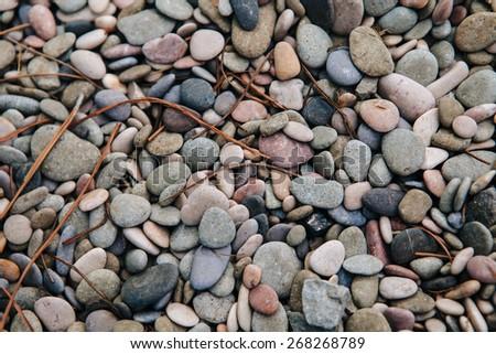 Circular sea pebbles - stock photo