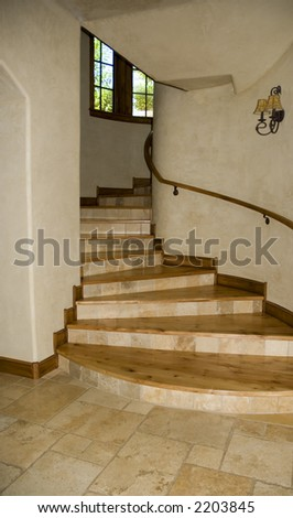 circular stairway with wooden floor and windows