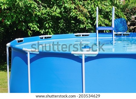 Circular water pool at garden with chlorine float and for Pool won t show chlorine