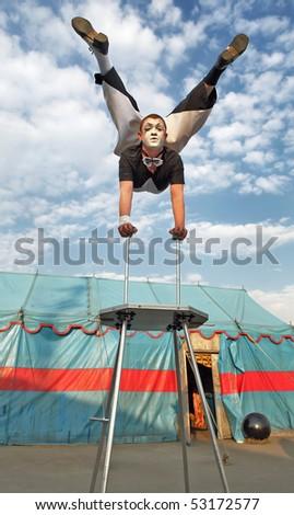 Circus acrobat with a plastic body executes his  tricks. Photo. - stock photo