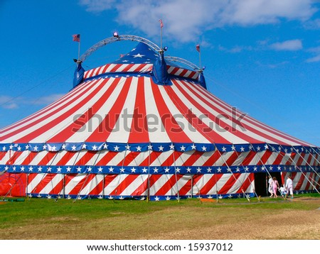 Circus big top tent in field decorated with stars and stripes. - stock photo