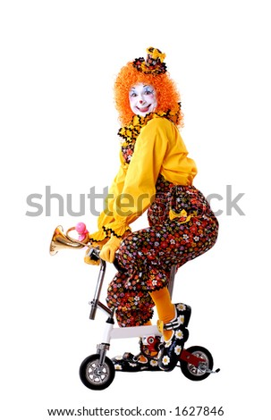 Circus Clown Riding a Tiny Bicycle - stock photo