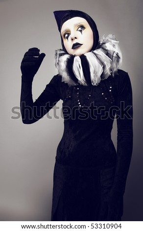 Circus fashion mime posing on a grey background. Photo. - stock photo