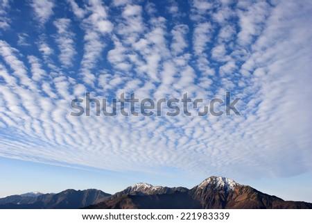 Cirrocumulus clouds in blue sky - stock photo
