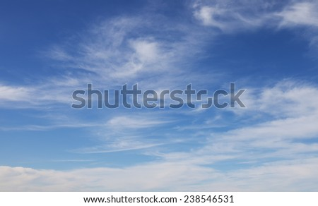 Cirrus clouds against the blue sky - stock photo