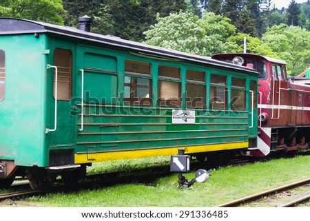 CISNA, POLAND - JUNE 04: Narrow-gauge railway, steam train. Tourist train rides in summer from Cisna to Przyslup in Bieszczady mountains on June 04, 2015, Poland - stock photo