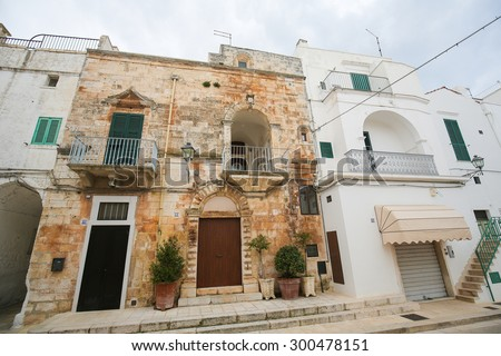 CISTERNINO, ITALY - MARCH 15, 2015: Historic houses in Cisternino, a comune in the province of Brindisi in Puglia, South Italy, known for its Salento wine