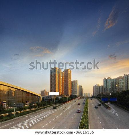 Cities and highways in the evening - stock photo