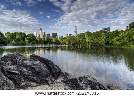 Citiscape over lake in Central Park, New York City - stock photo