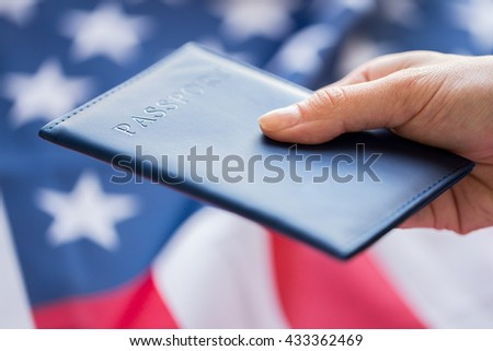 citizenship, patriotism and nationalism concept - close up of hand with american passport - stock photo