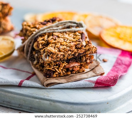 Citrus bars granola with oatmeal, seeds, nuts and dried fruits, healthy food - stock photo