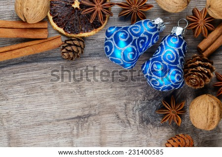 Citrus Christmas wooden table frame with baubles and spices - stock photo