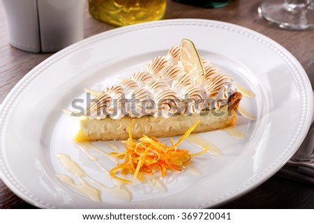 citrus cream cheesecake  piece with orange zest close-up on white plate   - stock photo