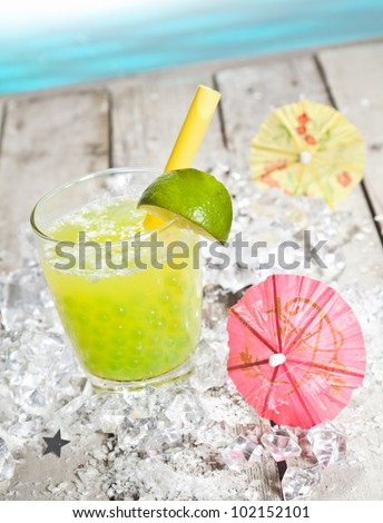 Citrus flavored Pearl Tea refreshment on a deck in front of the pacific ocean - stock photo