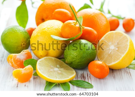 Citrus fresh fruit on the white wooden table - stock photo