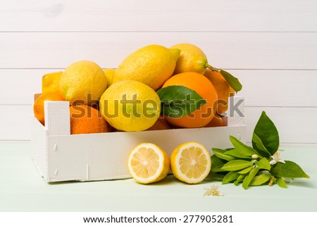 Citrus fresh fruits on wooden table background. - stock photo