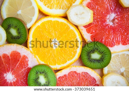 Citrus fruit background with a group of oranges lemons lime tangerines and grapefruit as a symbol of healthy eating and immune system boost with natural vitamins. - stock photo