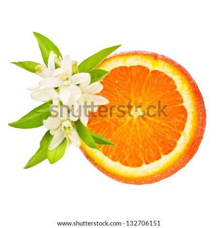 citrus fruit - orange , cut off from the side, decorated with flowers and leaves isolated on white background - stock photo