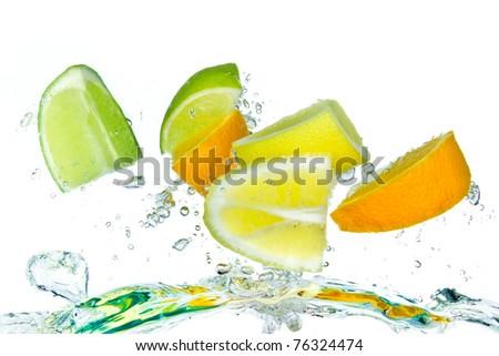 citrus fruit splashing isolated on white background - stock photo