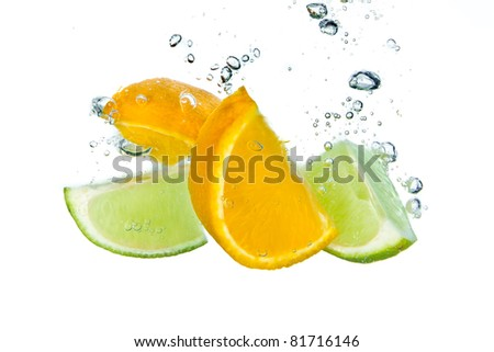 citrus fruit splashing isolated on white background - stock photo