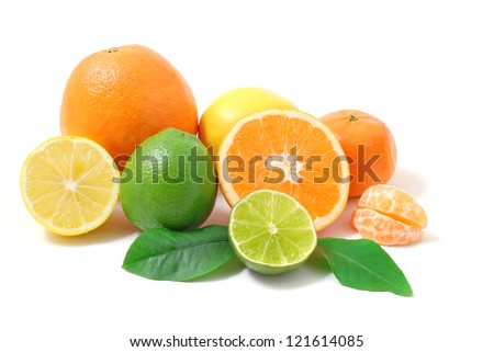 Citrus fruits. Citrus fruits with green leaves. Citrus fruits isolated on white background. Healthy citrus fruits. Citrus fruits - lemon, orange and lime. - stock photo