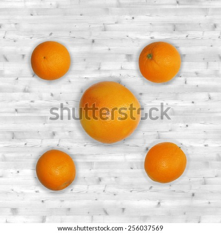 Citrus fruits (grapefruit and orange) on white planked wooden table - still life from above - stock photo