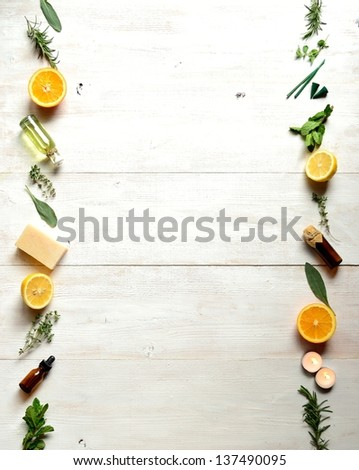 Citrus fruits,herbs and aromatherapy supplies.on white wood background - stock photo