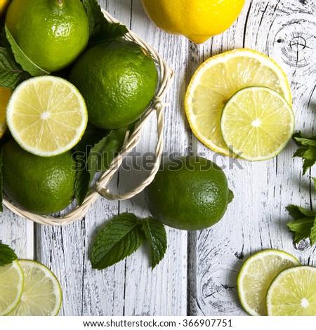 Citrus fruits in basket. - stock photo