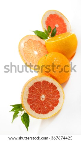 Citrus fruits isolated on white - stock photo
