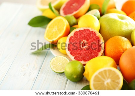 Citrus fruits on a blue wooden table - stock photo
