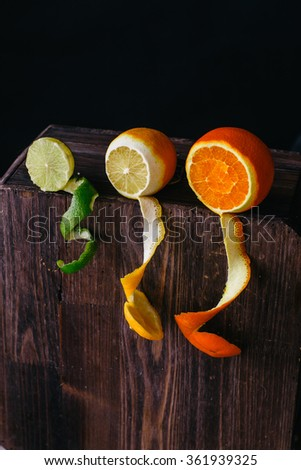 citrus fruits on old wooden boards