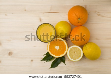 citrus fruits on the wooden table
