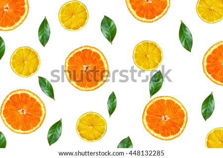 Citrus fruits orange and lemon with green leaves on white. Flat lay, top view