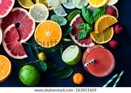 Citrus juice and slices of orange, grapefruit, lemon. Vitamin C. Black background - stock photo
