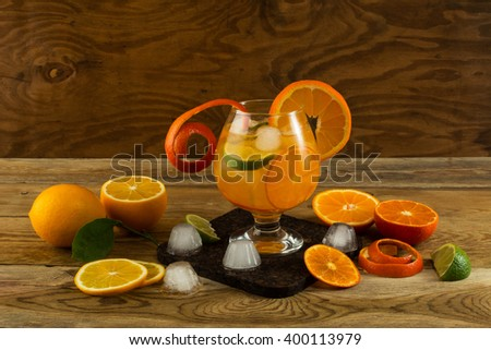 Citrus lemonade on wooden background. Fruit cocktail. Fruit drink. Fruit juice. Fruit lemonade. Summer drink - stock photo