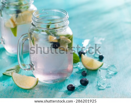 Citrus lemonade with blueberry and mint, selective focus - stock photo
