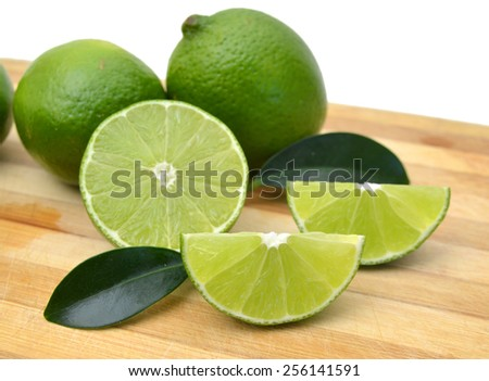 Citrus lime fruit isolated on wooden board  - stock photo