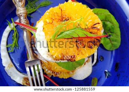 Citrus salad closeup.Oranges and fennel with herbs and balsamic vinegar.Vitamin salad.Healthy, light, raw food. Diet detox concept.Winter fruit salad. - stock photo